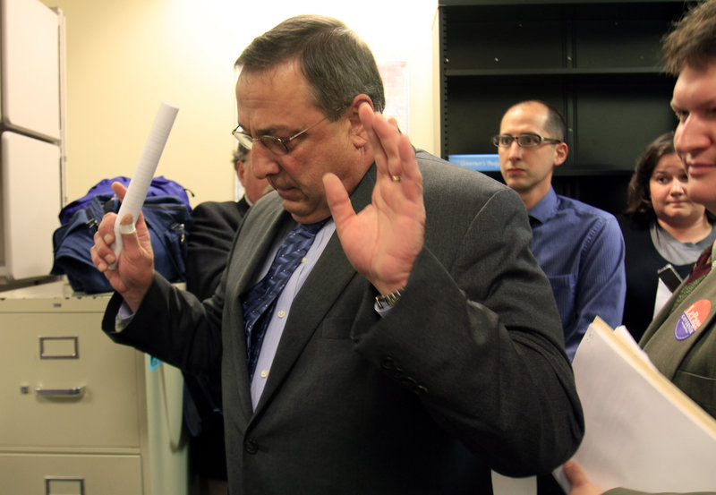 Gubernatorial candidate Paul LePage abruptly exits a news conference Monday in Augusta, irritated by questions about property taxes paid on his wife's Maine and Florida homes.