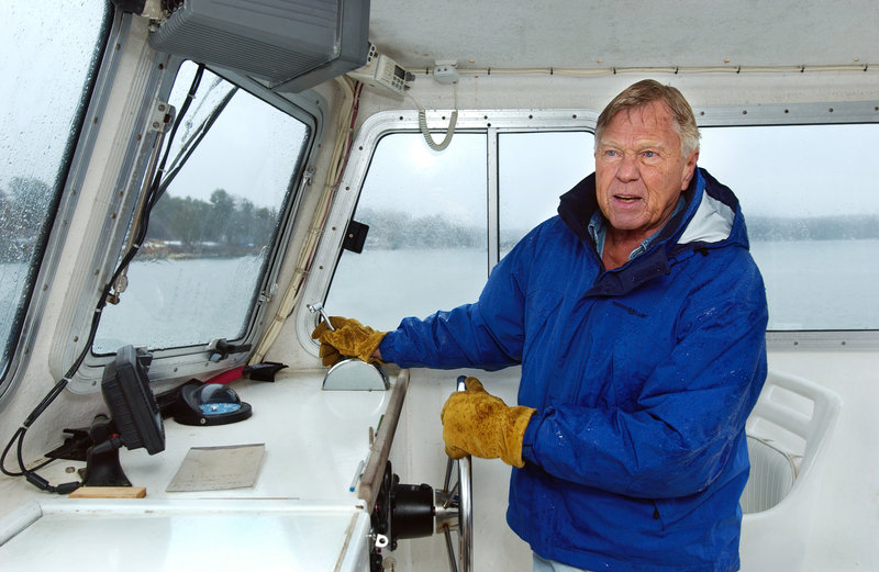 Dodge Morgan guides his boat alongside the dock at his island home in Harpswell during a rainy morning in April 2005. As a young man, he had promised himself he would sail around the world after he turned 30.