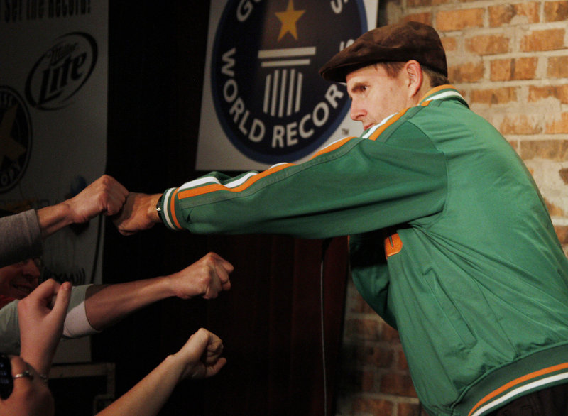 Maine comedian Bob Marley fist-bumps with the crowd after breaking the Guinness World Record for the longest standup comedy performance Thursday. The previous record of 38 hours and 6 minutes was held by Lindsay Webb of Australia.