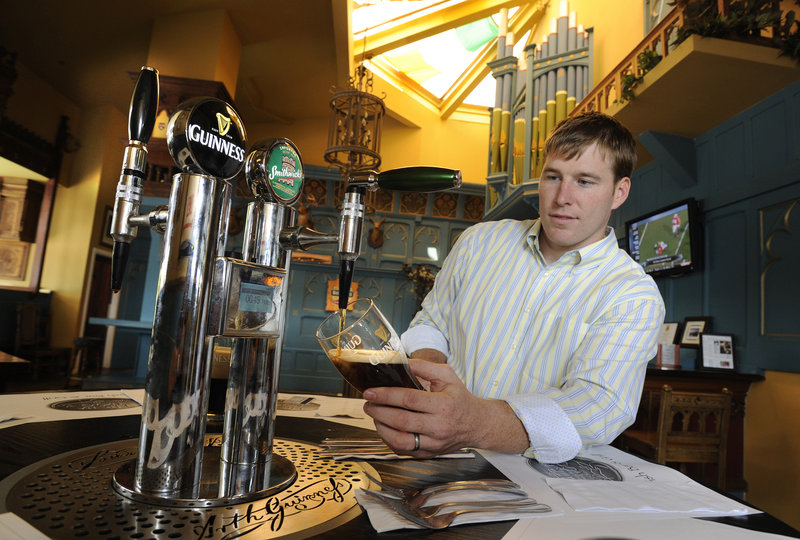 Josh Goodman, director of U.S. Operations for Ellickson International, pours a pint of Smithwick's Irish Ale from the table beer tap at Tir Na Nog, an Irish pub in the Inner Harbor in Baltimore, Md., that was trying the tap.
