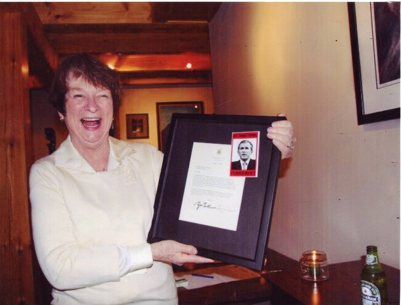 """In an undated photo released by the Maine Republican Party, Democratic candidate Libby Mitchell holds an image of President George W. Bush that labels him an """"international terrorist."""" Mitchell has apologized for the photo's message."""