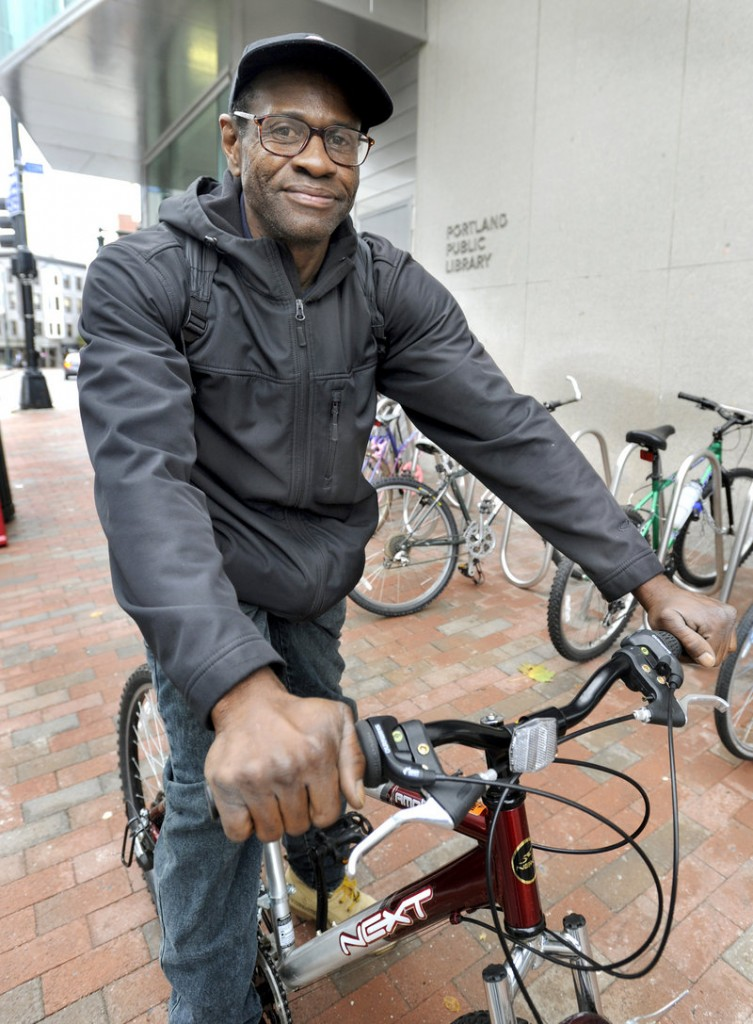 Dan Wright rides his bicycle every day from Portland to a job in Westbrook. He plans to get free of assistance soon.