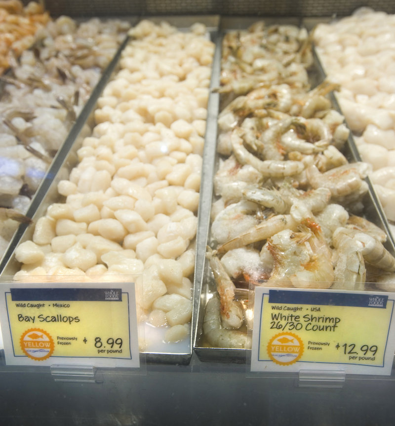 Whole Foods labels on wild-caught bay scallops and white shrimp indicate that they were harvested in Mexico and the USA, respectively, that they were previously frozen, and bear a yellow designation, which suggests some concerns with a fish s status or catch methods.