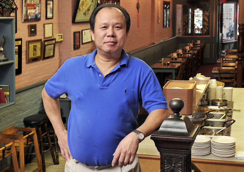 """Yan Lam offers a popular luncheon buffet at the Oriental Table, 106 Exchange St. in Portland. """"I don't mind the hard work at all,"""" he said."""