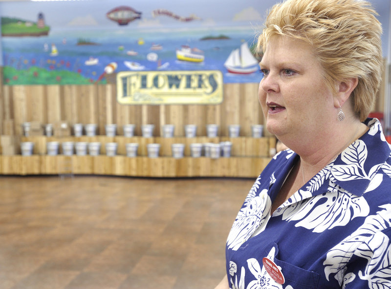 Tracey Acciola is the store captain at Portland's Trader Joe's. She is featured water skiing in a mural in the store.