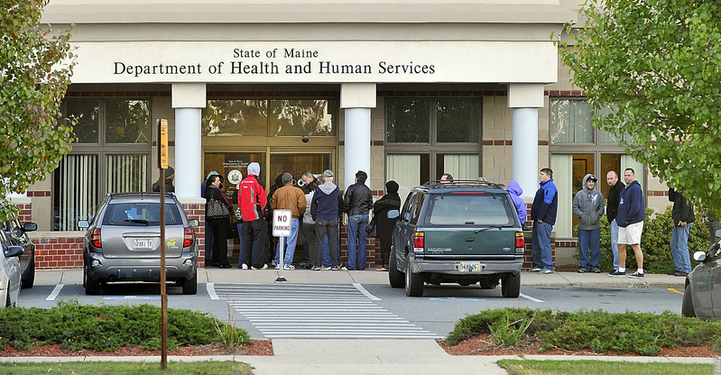 People line up outside the Maine Department of Health and Human Services office on Marginal Way in Portland before it opens at 8 a.m. Maine's gubernatorial candidates have widely differing views about welfare.