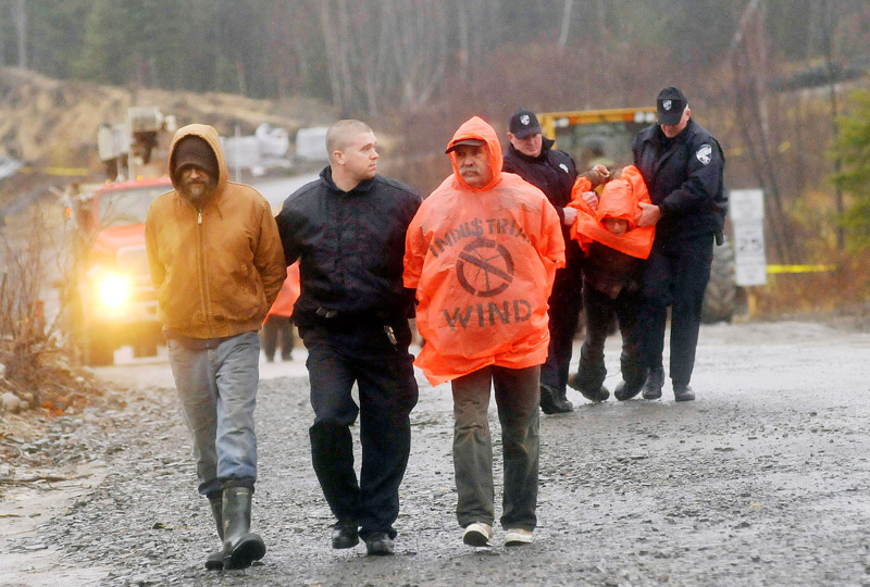 Staff Photo by Shawn Patrick Ouellette: Protesters are arrested after blocking construction vehicles at the Rollins wind energy project in Lincoln Monday, Nov. 8, 2010.