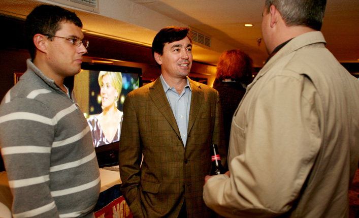 Rob Lally, middle, treasurer of Black Bear Entertainment, visits with Zac Creps of Oxford, left, and Mark Ferguson of Poland Springs, during the Yes on 1 Four Season Resort and Casino reception at DiMillos Floating Restaurant.