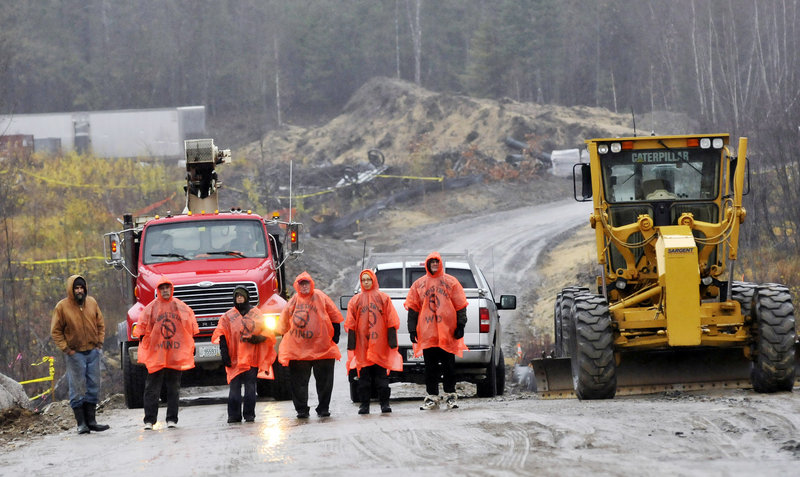 Demonstrators form a blockade of construction vehicles Monday morning at the 40-turbine, $130 million Rollins Mountain wind-power project being built by First Wind in Lincoln.