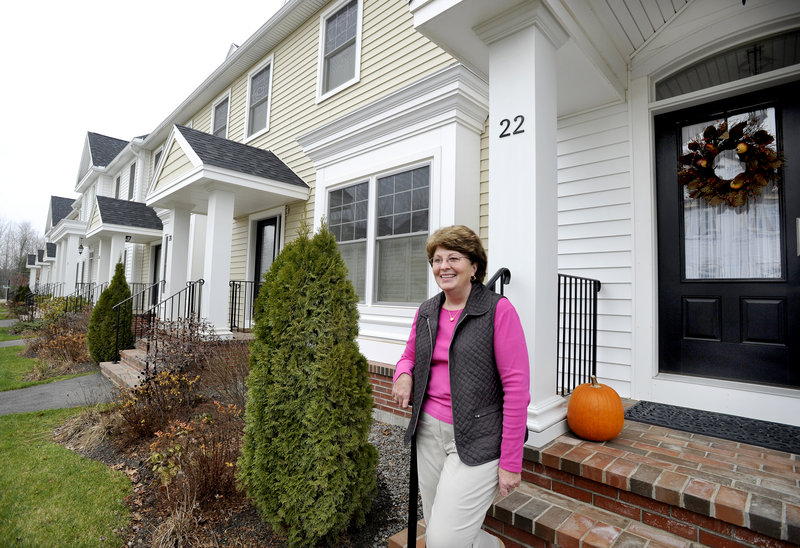 Lynne Beal and her husband moved to a townhouse in Dunstan Crossing last year, after retiring here from Cape Elizabeth. She said that living in the condos, set amid single-family homes full of kids riding bikes, reminds her of her Bangor childhood.