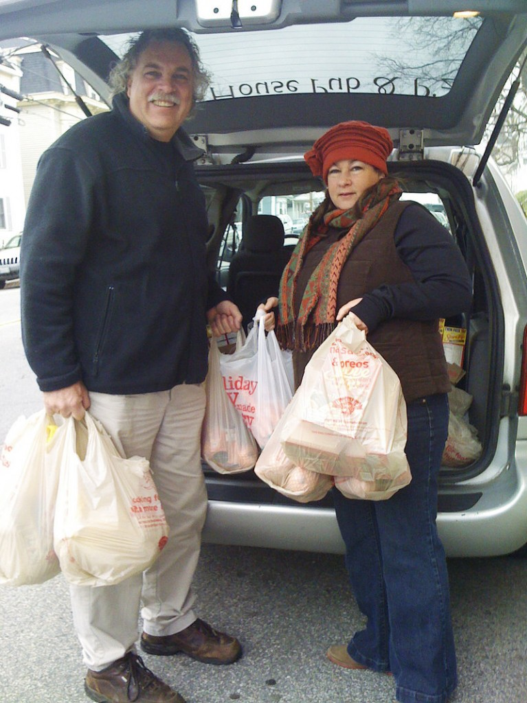 Jack and Vassie Fowler unload turkeys from their minivan Monday morning at the Stone Soup Food Pantry in Biddeford.