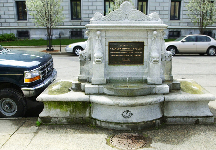 New granite seating around the Stanley Pullen Memorial Fountain will help prevent vehicles from parking too close and protect it from snow plowing equipment in winter.