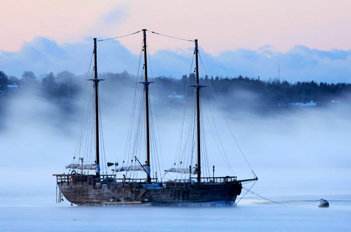 Sea smoke drifts by the Raw Faith in Rockland, Maine, In this Jan. 16, 2009, photo.