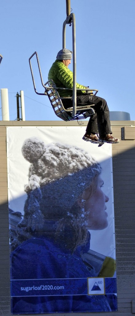 A skier rides on a chairlift Tuesday afternoon at Sugarloaf. A lift derailed in high winds at Maine's tallest ski mountain Tuesday, sending skiers plummeting as far as 30 feet to the slope below and injuring several people.
