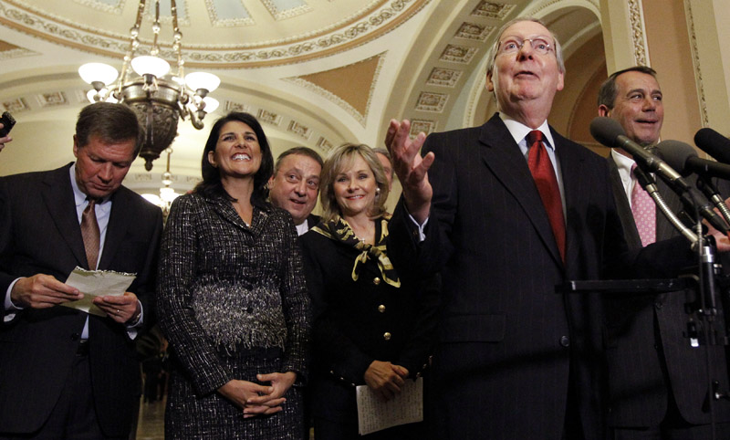 Senate Republican Leader Mitch McConnell, R-Ky., second from right, speaks as Ohio Gov.-elect John Kasich, left, stands with South Carolina Gov.-elect Nikki Haley, Maine Gov.-elect Paul LePage, Oklahoma Gov.-elect Mary Fallin, and House Speaker-designate John Boehner, R-Ohio, right, listen after their meeting on Capitol Hill on Wednesday.