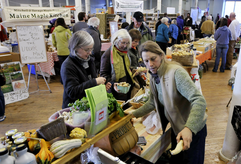 Jan Goranson of Goranson Farm in Dresden waits on customers last weekend at the bustling Brunswick Winter Market at Fort Andross.