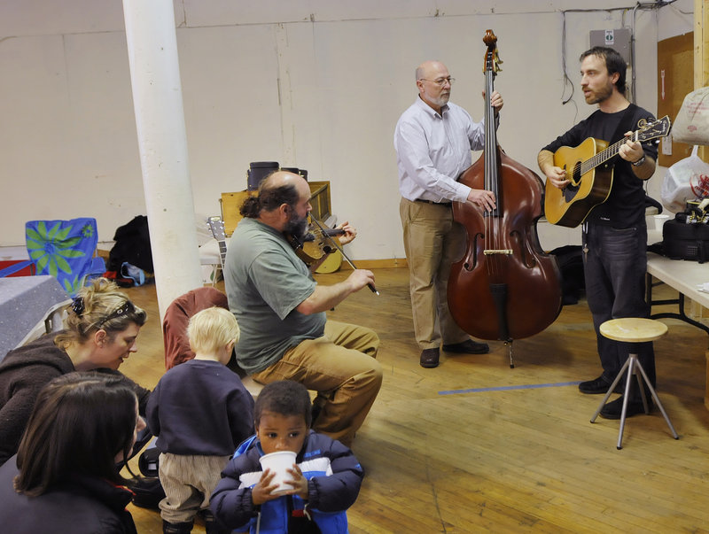 Musicians Jeff Raymond of Pownal, on the fiddle; Dick Durgin of Brunswick, on the upright bass; and Craig Hensley of Bowdoinham, on the guitar, entertain during the Brunswick Winter Market last Saturday.