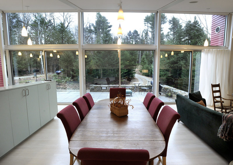 The dining area of Jane and Robert Weir's home in West Bath faces a solid wall of glass that brings in lots of light and encourages the feeling of coexisting with nature.