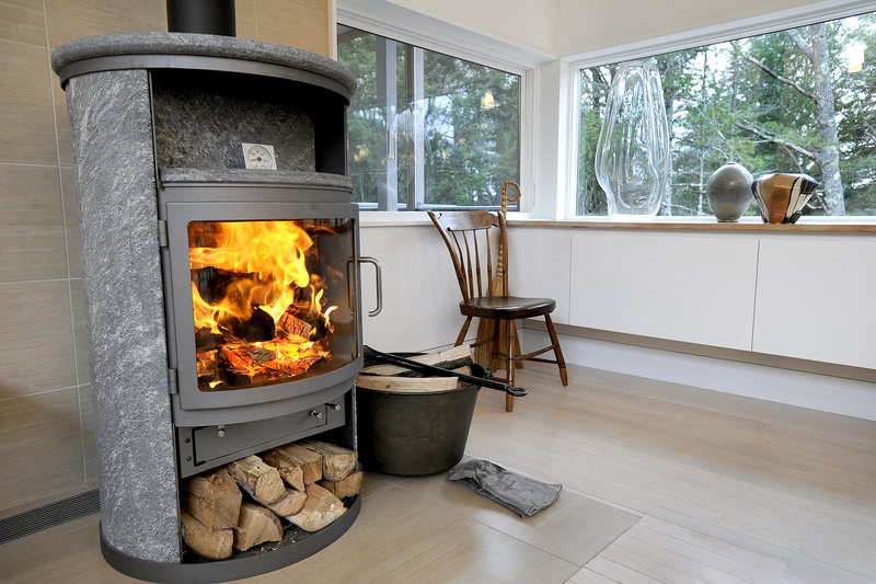 A fireplace at one end of the main living expanse.