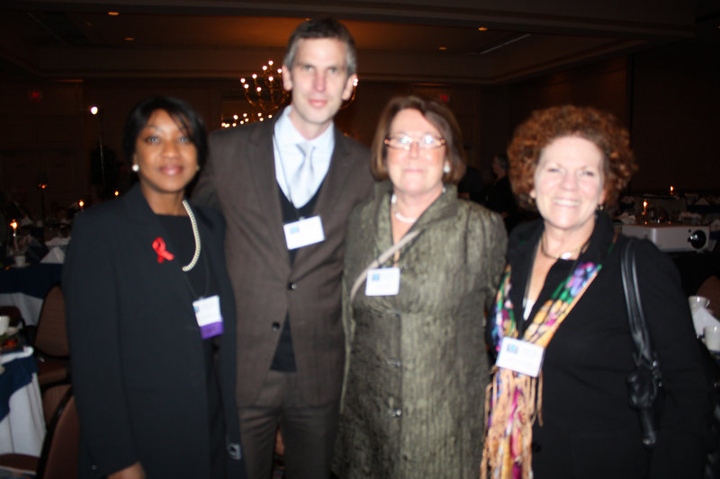 Honoree Dr. Chiedza Jokonya, left; Peter Cauwood and Jenifer Van Deusen, right, all of the Maine-Dartmouth Family Practice Residency; and Judith Burwell, of the Kaylor Co.
