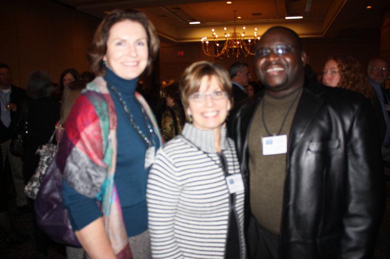 Maureen Clancy of Mercy Hospital; Leslie Brancato, the CEO of Portland Community Health Center; and Dr. Kolawole Bankole