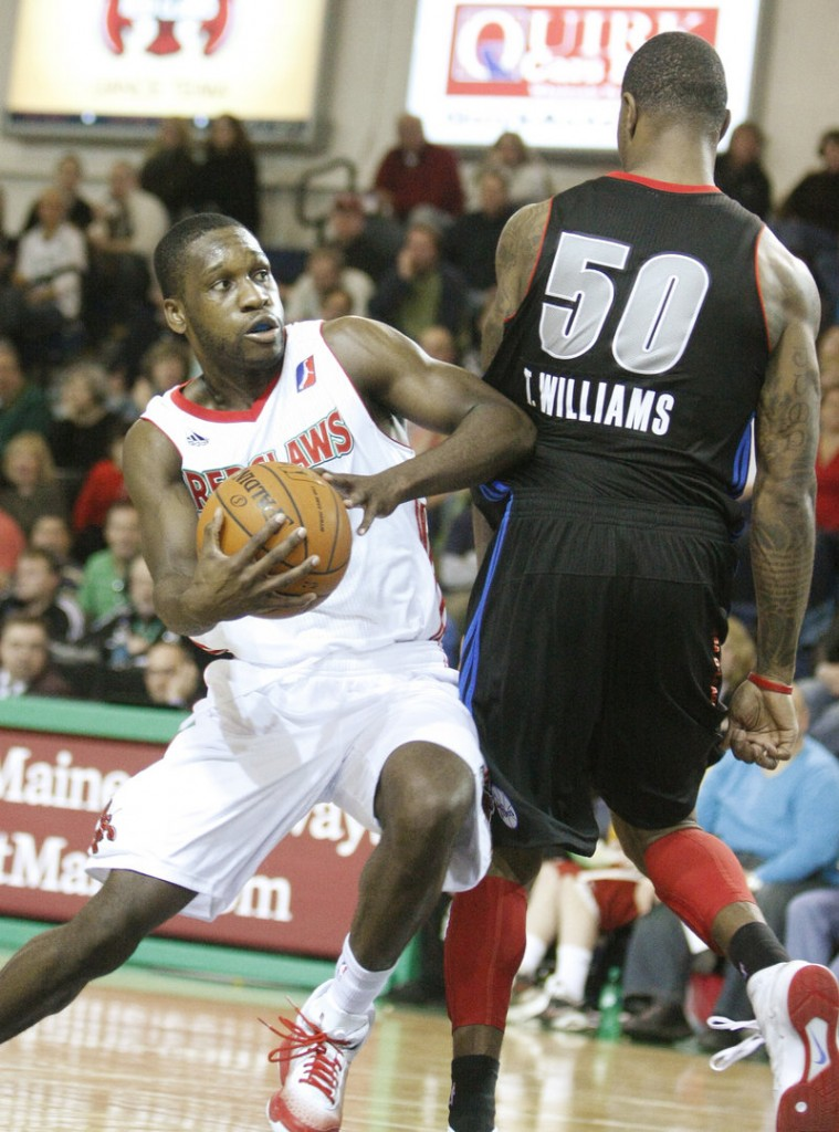 Champ Oguchi of the Red Claws drives past Terrence Williams of the Armor in the third quarter Sunday at the Portland Expo. Oguchi scored 16 points, joining five other Maine players in double-digit scoring.