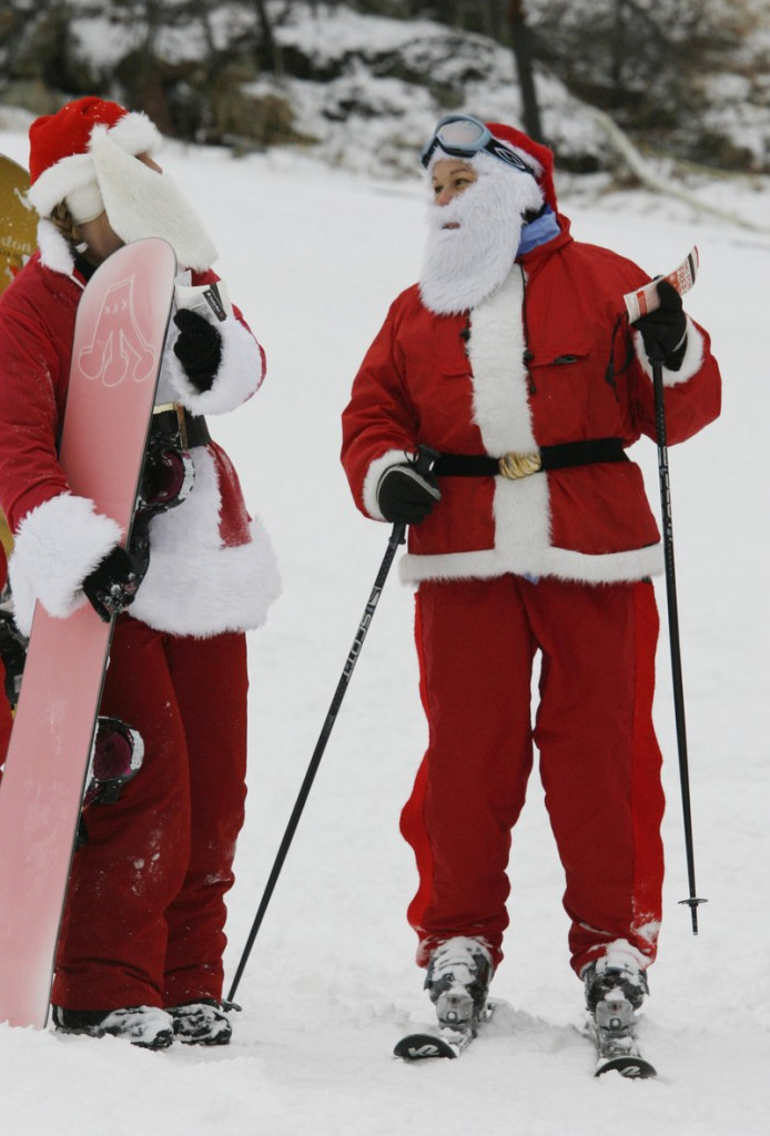 Lynn Philippone, right, speaks with Amy Bloodgood on Sunday during Santa Sunday at Sunday River in Newry. Participants got a free lift ticket if they gave to an annual toy drive.