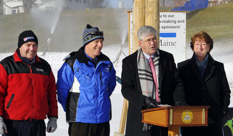Portland Mayor Nicholas Mavodones speaks from the podium. With him are Tim Rearden of Quirk Chevrolet, left, Greg Sweetser of Ski Maine and Councilor Cheryl Leeman.