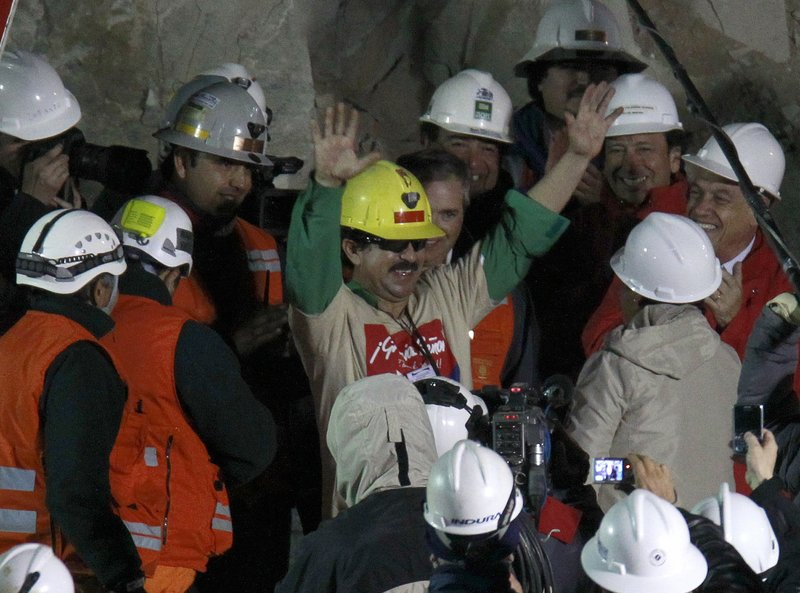 Chilean miner Juan Andres Illanes Palma, the third to be rescued, exits the collapsed San Jose gold and copper mine on Oct. 13. He was trapped with 32 other miners for more than two months.