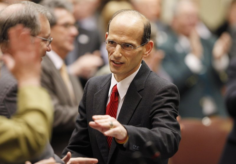 Gov. John Baldacci greets legislators after his State of the State address in 2009 at the State House in Augusta. Rather than see the bad economy as a hindrance, Baldacci insists it enabled him to push through changes that, in a good economy, would not have been possible.