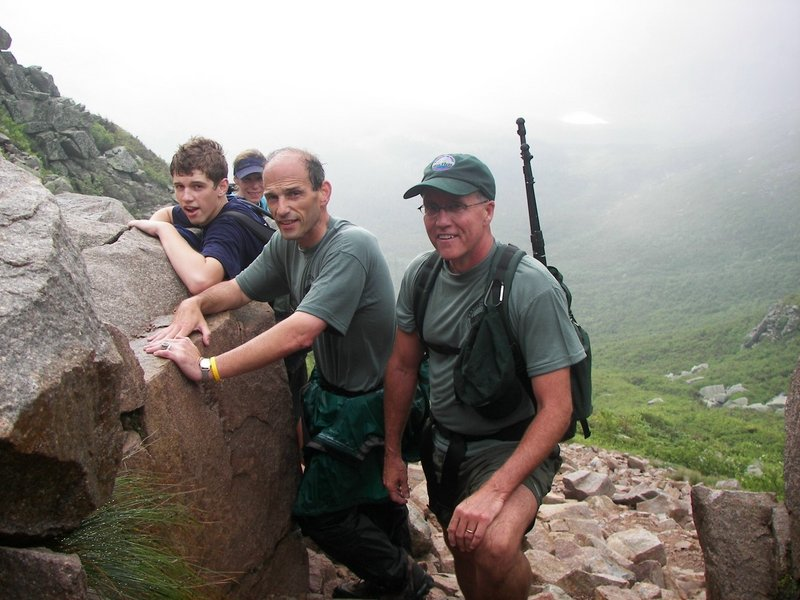 Jack Baldacci, Sheryl Tishman, Gov. John Baldacci and Baxter State Park Director Jensen Bissell, from left, posed on July 11, 2007, on the Saddle Trail of Mount Katahdin near Millinocket. Baldacci hiked up the mile-high mountain, Maine's tallest, with his son Jack and several others. Baxter State Park officials said he was the first sitting governor in more than 30 years to climb Katahdin. Baldacci protected access to many of Maine's special places, despite significant land sales.