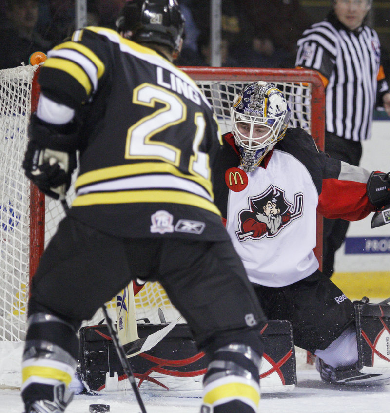 Pirates goalie Jhonas Enroth, making a save on Providence s David Ling, helped Portland survive a slow start by making 15 of his 24 saves in the first period and killed off four penalties. The period ended in a 1-1 tie.