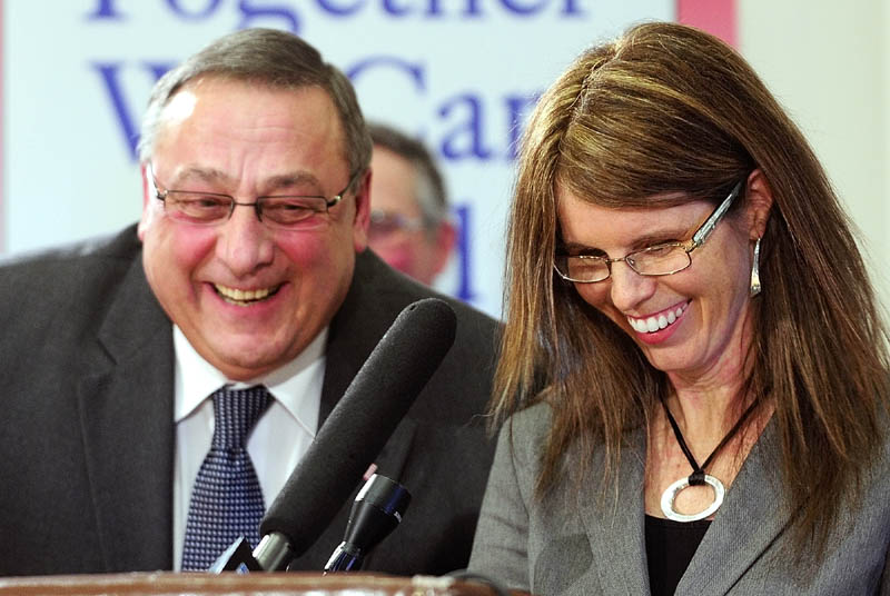 Gov. Paul LePage, left, and Mary Mayhew, his nominee for commissioner of the state Department of Health and Human Services, laugh during a press conference this morning in the State House's Cabinet room in Augusta.