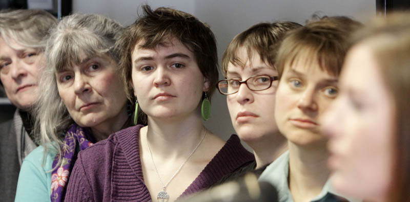 Sarah Standiford, far right, of the Maine Women's Lobby speaks at a news conference at the State House in Augusta today. Advocates for welfare programs in Maine say legislative debate over proposed cuts should be based on facts, not anecdotes suggesting widespread cheating and long-term reliance.