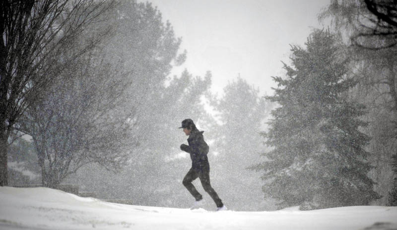 Staff photo by Michael G. Seamans A runner navigates his way through the heavy snow Wednesday morning at Colby College in Waterville.