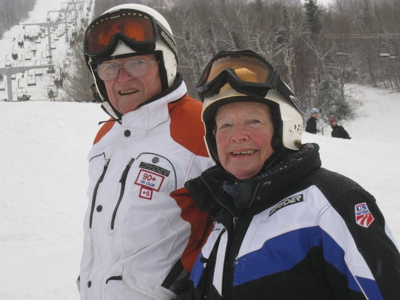 John Woodward, 95, and his wife, Lois, 84, are still enthusiastic skiers. John helped train World War II ski troops and later became a leader in the ski industry.