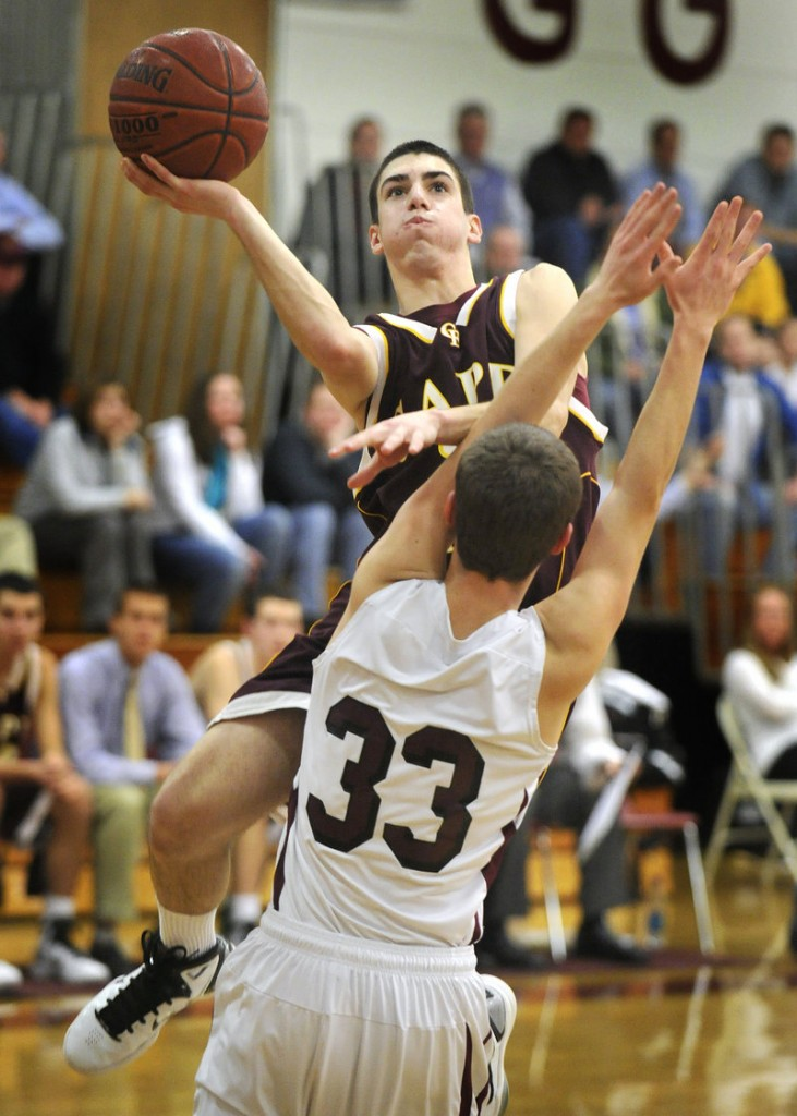 Cam Brown of Cape Elizabeth heads over Brad McKenney of Greely for a basket Tuesday during Cape Elizabeth's 55-41 victory at Cumberland. Each team is 5-1 in the tight Western Class B race.