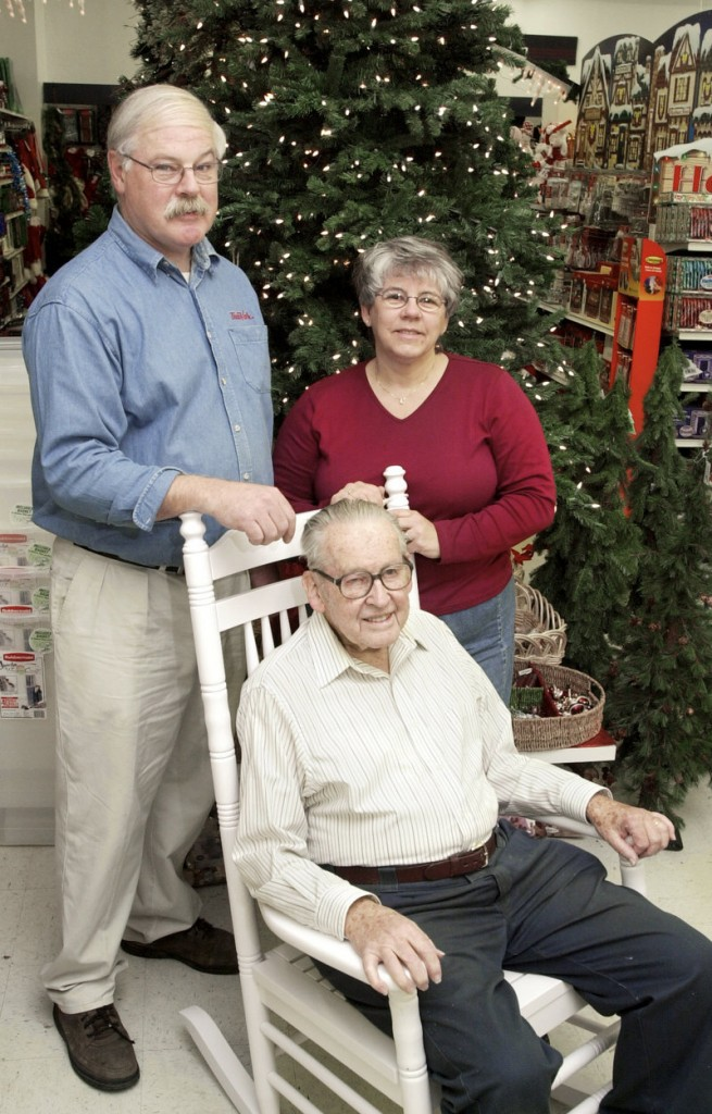 Tom and Maddie Simpson stand with Tom's father, Warren Simpson, at Shoppers True Value Hardware in South Portland in November 2003.