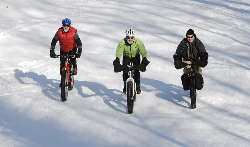 Alexander, Fenlason and Clarke, from left, are part of a growing group of fat-bike riders in Maine. They say the bikes give them the freedom to ride any terrain.