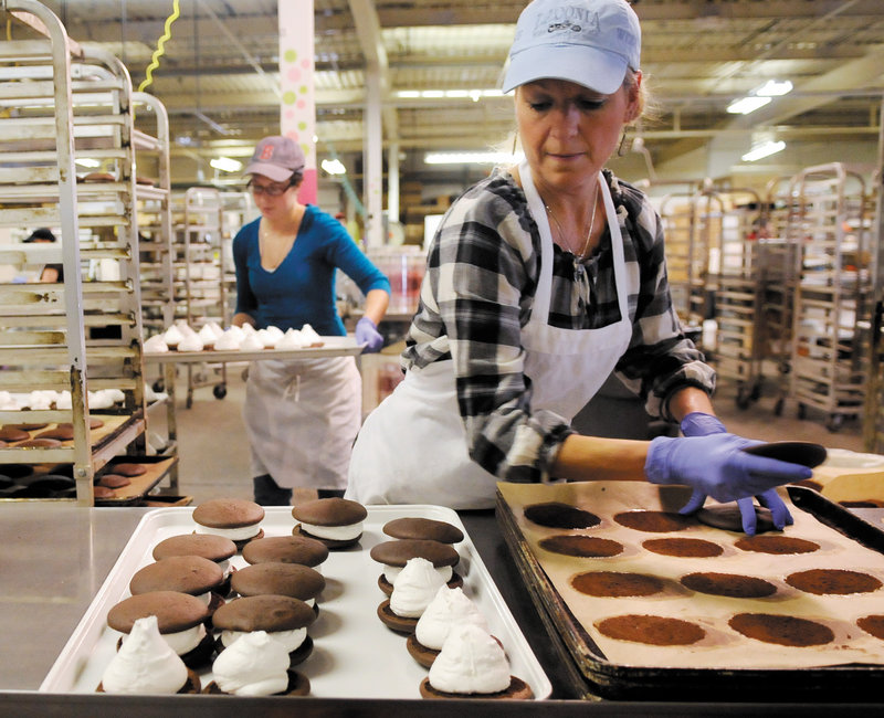 Diane Bouchard, right, and Kristen Averell prepare whoopie pies Friday at Isamax Snacks in Gardiner. A supporter of a proposal to make whoopie pies the official state dessert notes that Maine already has an official soft drink, Moxie.