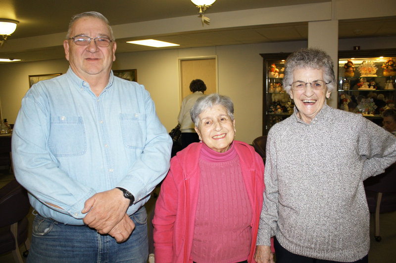 John Pettengill, who drives the Woods at Canco shuttle, Lonnie Norton and Louise Standley.
