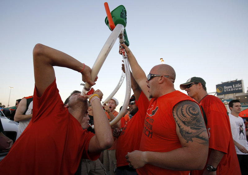 Miami football fans party before a recent college football game between Miami and Florida State in Miami. A study found sports fans younger than 35 were nine times likelier to be above the legal limit for blood alcohol after a game.