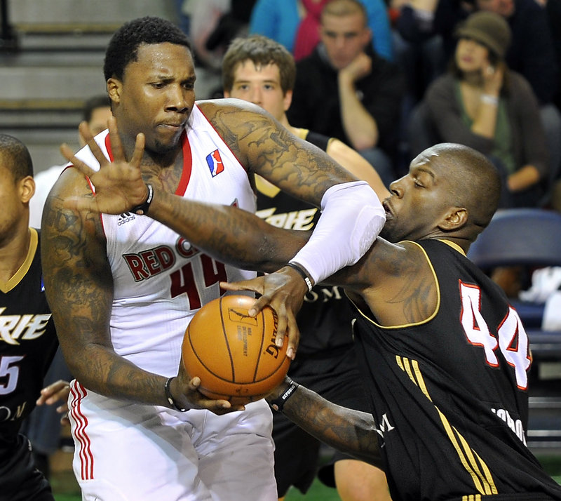 Maine's Tiny Gallon tries to muscle past Ivan Johnson of the Erie BayHawks in a 113-109 loss at the Portland Expo on Friday. Gallon had 22 points and helped hold Johnson to 12.