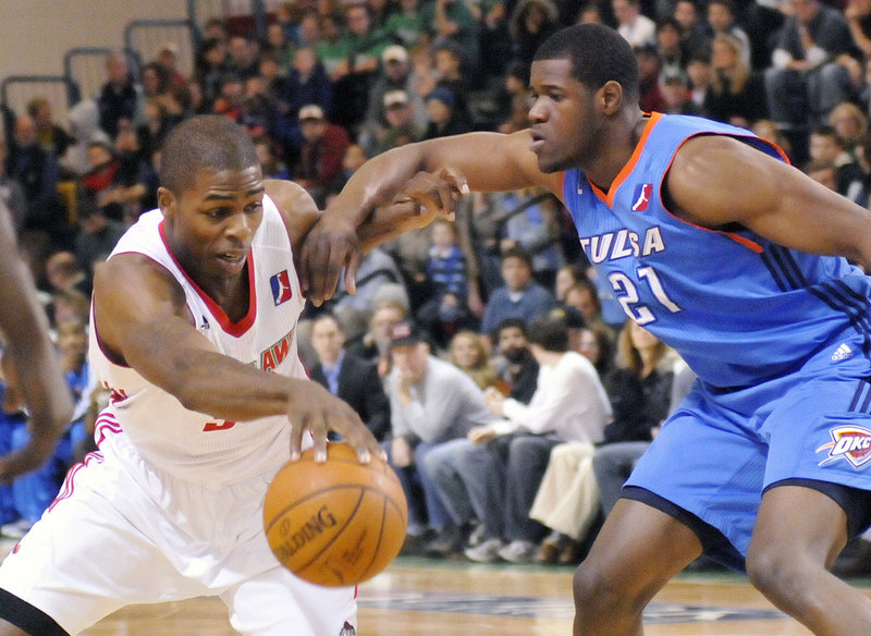 Maine's DeShawn Sims, fighting off Tulsa's Latavious Williams, led the Red Claws with 26 points, including two with 13 seconds left that gave Maine the lead for good.