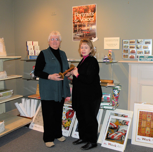 Museum L-A's gift shop. Susan Bean, the archivist and public relations coordinator for the museum, is on the right.