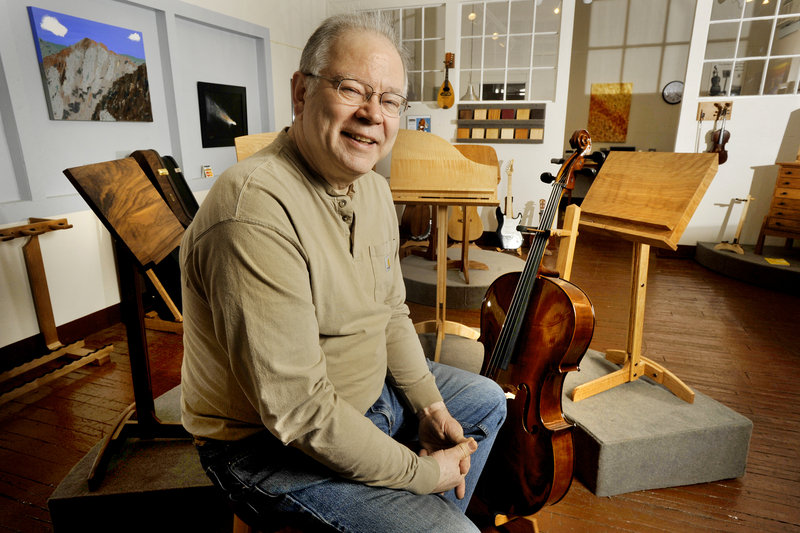John Stass has found a niche making music room furniture and selling it all over the world. Stass' custom-designed pieces appeal to professionals who are passionate about a musical hobby and want something other than metal or plastic display racks or cabinets for their instruments and accoutrements.
