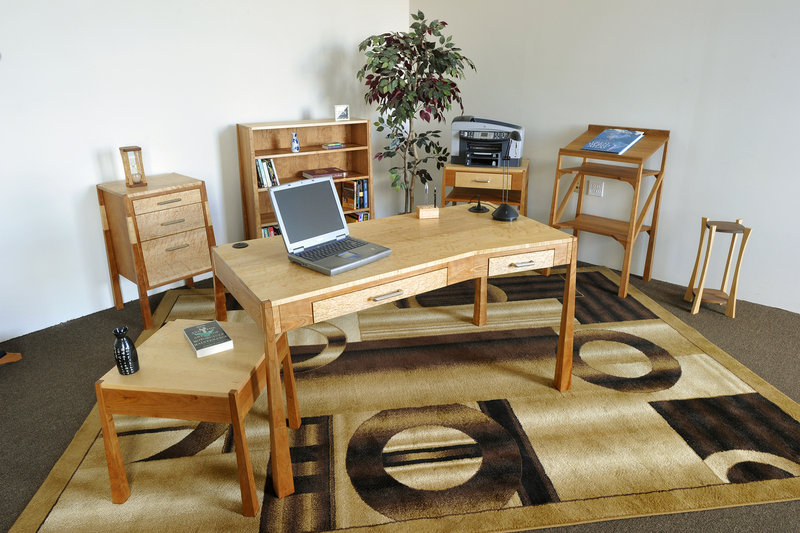 John Stass, owner of Katahdin Studio Furniture, got into the business of making music room furniture when he was looking for some for himself and found little available. Fifteen years later, Stass is expanding his woodworking to include custom office and home furniture in his Zen Modern Collection. Stass and his staff work from a space in the Lewiston Hill Mill.