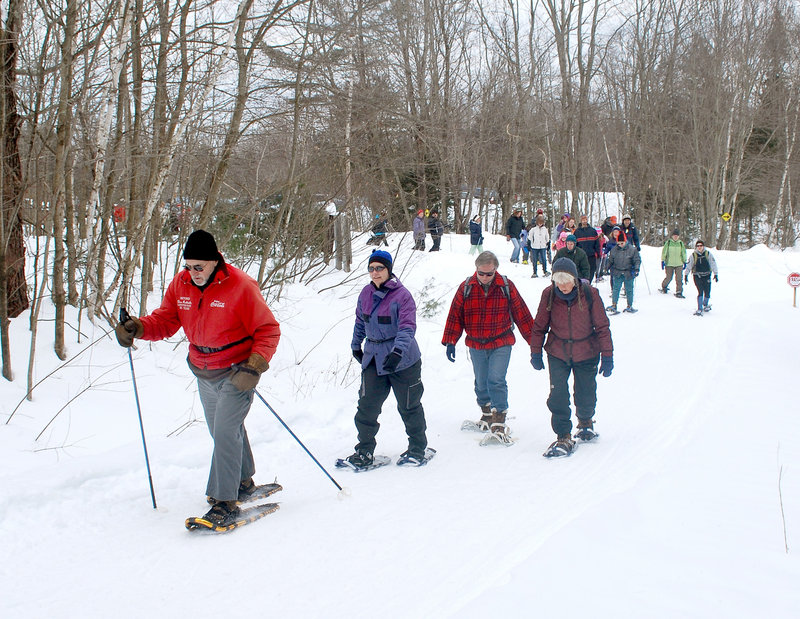 Don Robitaille of Lewiston leads a group of snowshoers during a hike at Androscoggin Riverlands State Park in Turner. A group of nearly 60 showed up for the first hike in the series, which continues Saturday.
