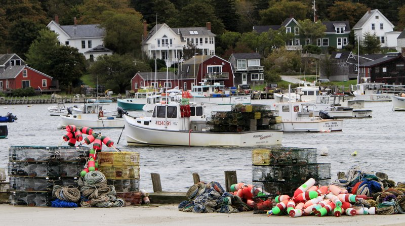 Lobster traps and gear are seen on a wharf on Vinalhaven in this Oct. 6, 2010 photo. A Maine lawmaker has introduced a bill this legislative session that makes it legal for traps to be stored on docks year-round.