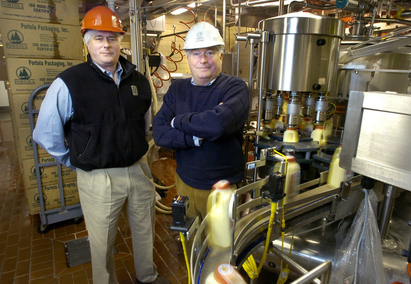 Stanley Bennett, right, and his brother William led Oakhurst Dairy's efforts to reduce the use of fossil fuels by improving the efficiencies of existing equipment and using cleaner energy sources.